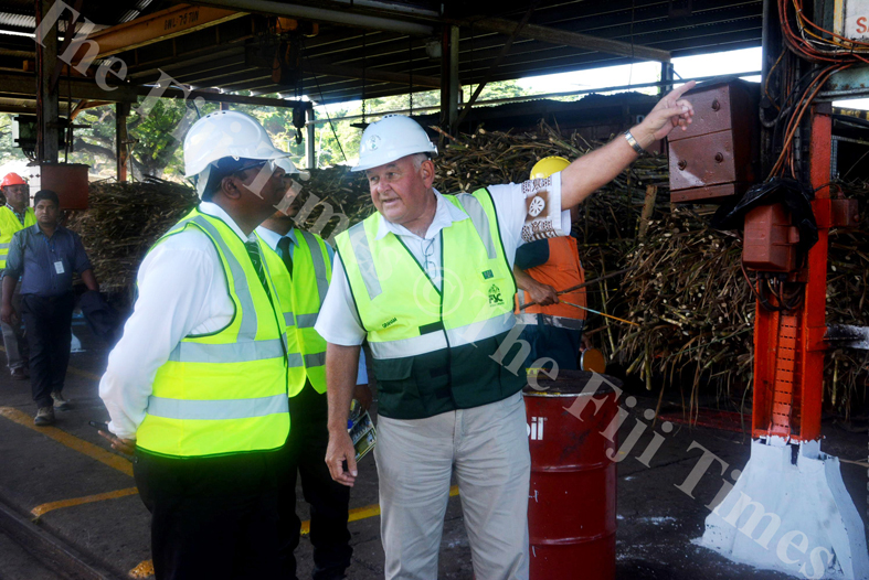 Fiji Sugar Corporation CEO Graham Clark (right) explains improvements made to the Lautoka mill to Waterways Minister Dr Mahendra Reddy yesterday. Picture REINAL CHAND