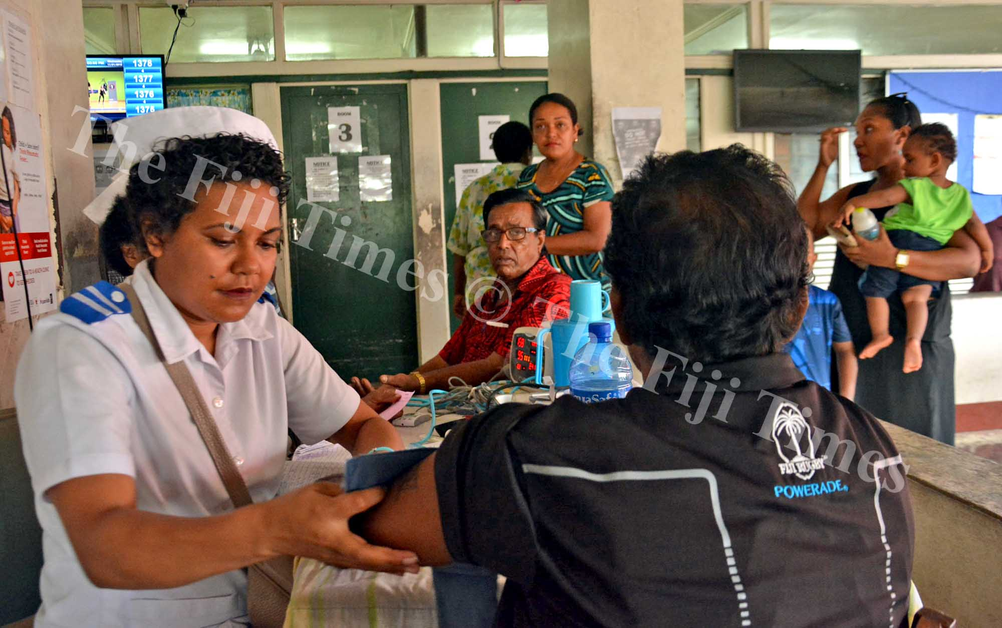 Staff nurse Lanieta Talolo, left, attends to patients at the Valelevu Health Centre in Nasinu on Wednesday, January 17, 2018. Picture: JONACANI LALAKOBAU
