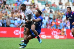 Amenoni Nasilasila is stopped by USA flyer Carlin Isles in the Cup quarter final match during HSBC World Sevens Series Sydney 7s tournament at the Allianz Stadium on Sunday, January 28, 2018. Picture-JONACANI LA (1)