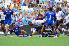Mesulame Kunavula is stopped by the USA defence  in the Cup quarter final match during HSBC World Sevens Series Sydney 7s tournament at the Allianz Stadium on Sunday, January 28, 2018. Picture-JONACANI LALAKOBAU