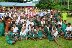 Vunisaiki District School students pose a photo with PM Voreqe Bainimarama during his vist to their school. Picture LUKE RAWALAI