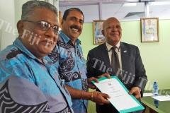 Ba Senior Citizens Association's Seg Ram (left) and Arun Sharma recieve the grant documents from Permanent secretary Dr Joe Koroivueta in Suva on Tuesday. Picture: ELIKI NUKUTABU