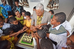 Prime Minister Voreqe Bainimarama cuts the cake with the students of Nausori Primary School after opening the extension of the new blocks to the school yesterday. Picture: RAMA