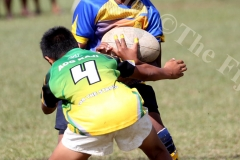 Suva Primary School u12 Calum Tavaga on the attack against Assemblies of God  Primary School at St Marcelin Primary School grounds yesterday. Picture: JONA KONATACI