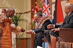 Prime Minister Peter Paire O'Neil of the Independent State of Papua New Guinea is traditionally welcomed by the Prime Minster Voreqe Bainimarama at GPH yesterday. Picture: RAMA