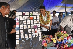 Permanent Secretary for Industry,Trade and Tourism Shaheen Ali (nearest to camera) looks at the artifacts during the Ministry of Trade and Industry certificate presentation to traders at Sukuna Park on Saturday. Picture: RAMA